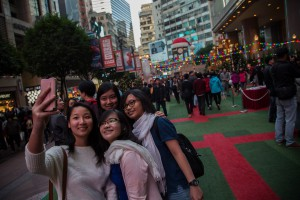 Shoppers In Causeway Bay and Tsim Sha Tsui Districts Ahead Of Holiday Season