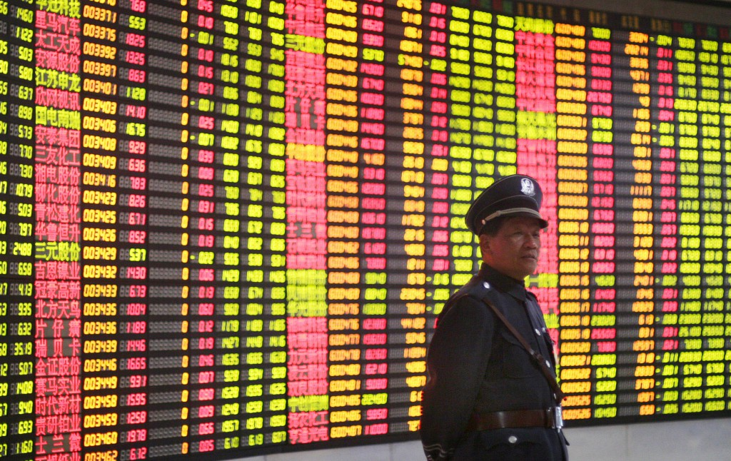 A Chinese investor watch the trade index in a small trade floor on 5 January 2004 in Shanghai, China.