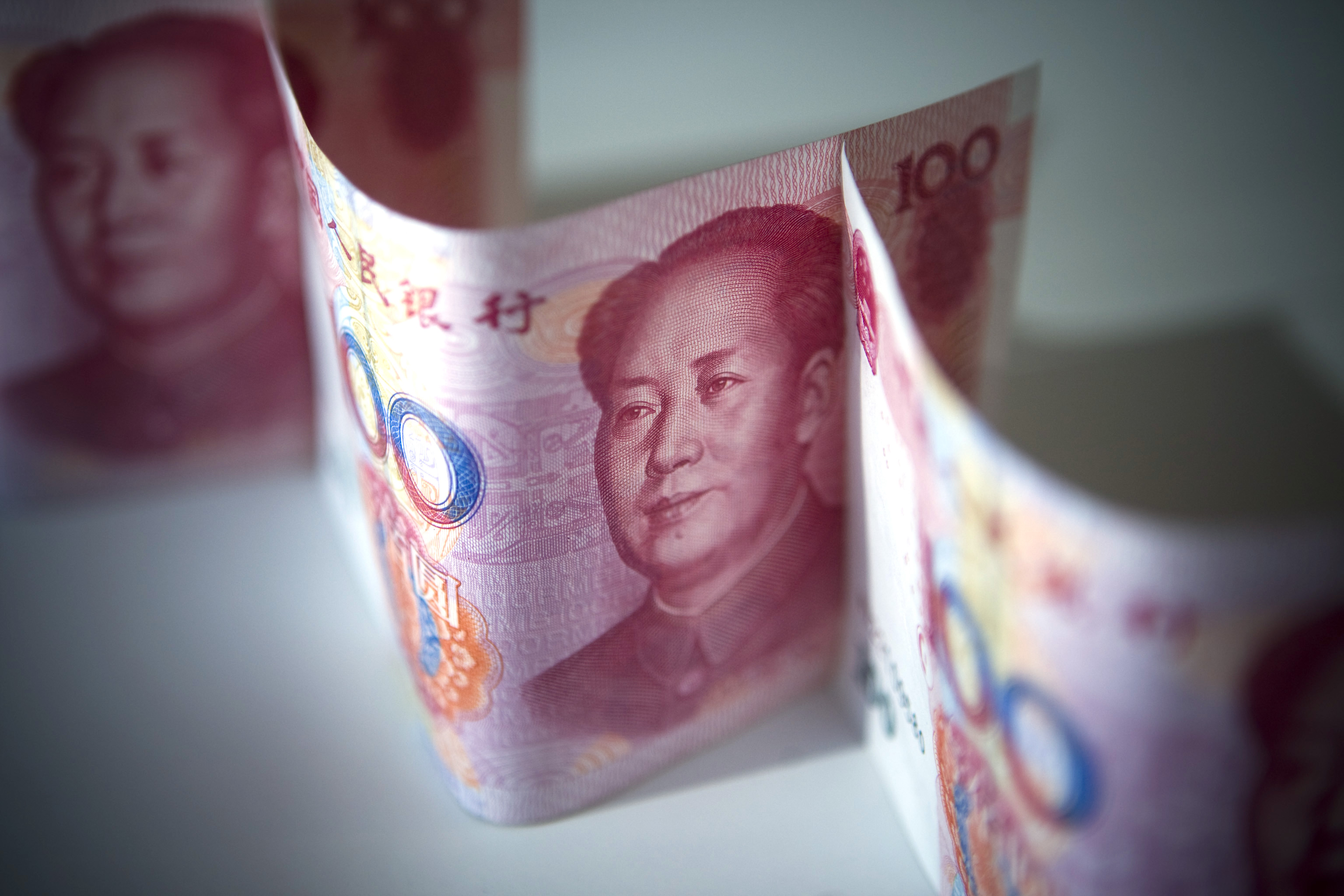 Chinese Renminbi bank notes are displayed for a photograph in Beijing, China, on Friday, Jan 9, 2009. The yuan headed for the first weekly decline since the five days through Dec. 19 on speculation China is preventing gaines to aid exporter and stimulate economic growth. Bonds advanced. Photographer: Nelson Ching/Bloomberg News