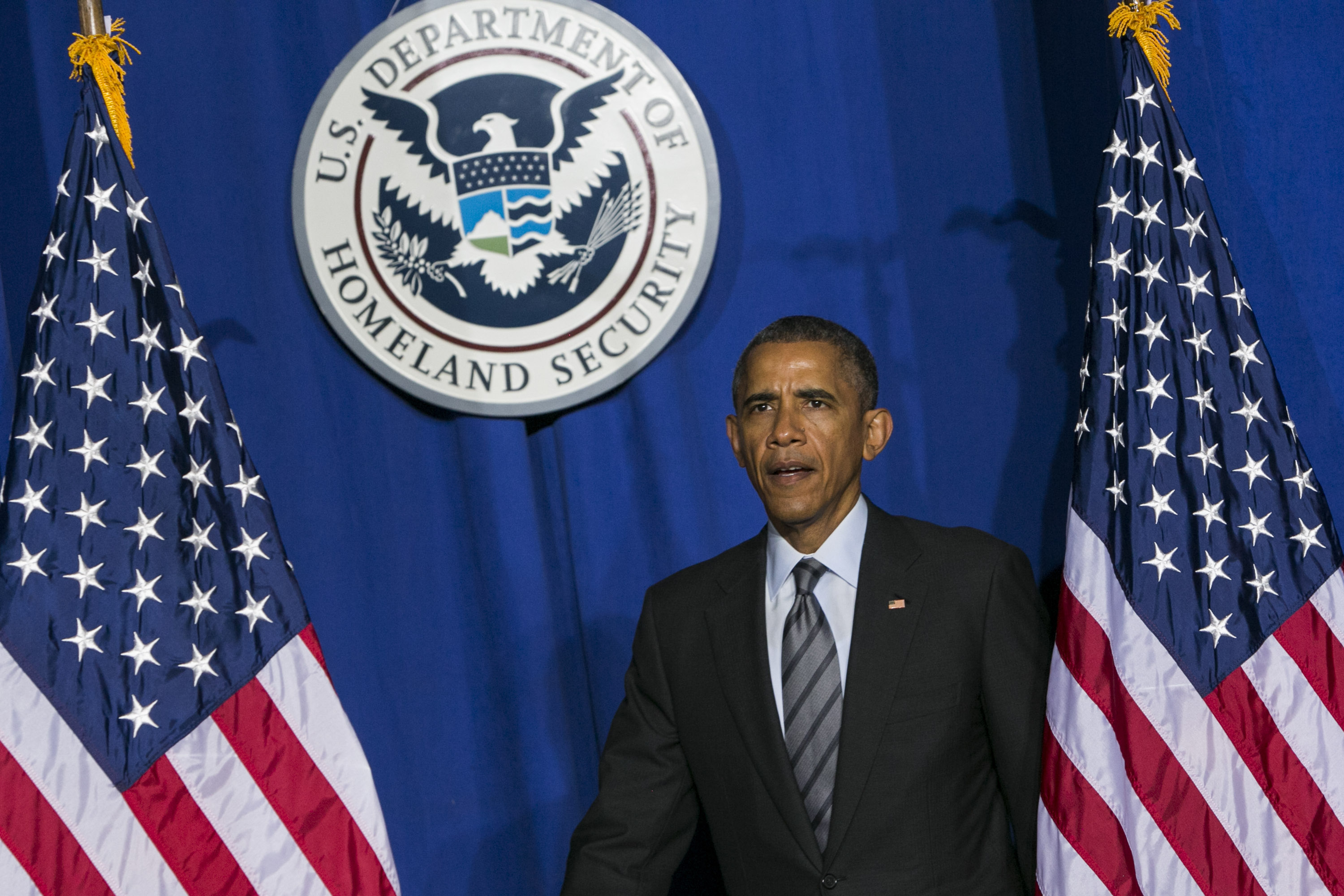 U.S. President Barack Obama arrives to deliver remarks on his Fiscal Year 2016 Budget at the Department of Homeland Security (DHS) in Washington, D.C., U.S., on Feb. 2, 2015. Obama sent Congress a $4 trillion budget that would raise taxes on corporations and the nation's top earners, spend more on infrastructure and housing, and stabilize, but not eliminate, the annual budget deficit. Photographer: Kristoffer Tripplaar/Pool via Bloomberg *** Local Caption *** Barack Obama