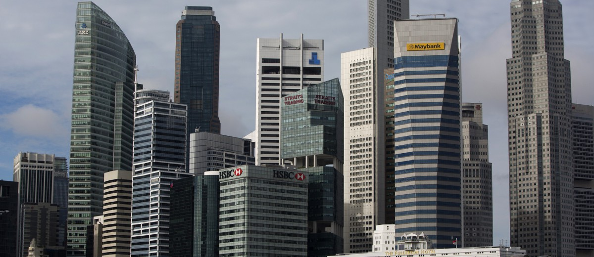 Commercial buildings stand in the central business of Singapore, on Monday, Dec. 9, 2013. Photographer: Brent Lewin/Bloomberg