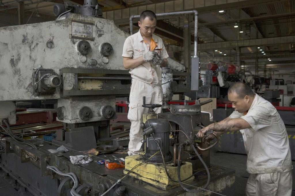 中国的工人面对失业或收入减少的问题