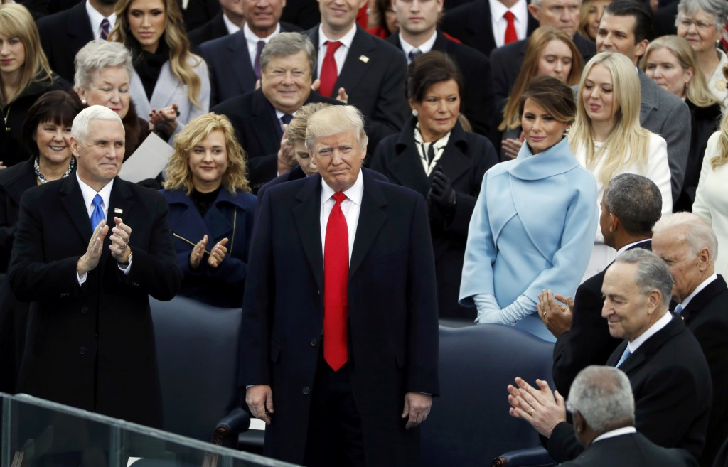 Donald Trump receives applause during his inauguration ceremonies to be sworn in as the 45th president of the United States at the U.S. Capitol in Washington, U.S., January 20, 2017. REUTERS/Lucy Nicholson