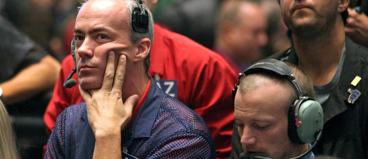Traders work in the S&P 500 pit just before Ben S. Bernanke, chairman of the U.S. Federal Reserve, addresses an annual central bank conference in Jackson Hole, Wyoming, U.S., on the floor of the CME Group's Chicago Board of Trade in Chicago, Illinois, U.S., on Friday, Aug. 26, 2011. Photographer: Tim Boyle/Bloomberg *** Local Caption ***