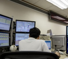 A stockbroker works in front of a monitor displaying share prices at a securities brokerage in Hong Kong, China, on Thursday, April 9, 2015. Hong Kong stocks surged the most since 2009 amid volume more than four times the average and a frenzy of buying by mainland investors. Photographer: Billy H.C. Kwok/Bloomberg