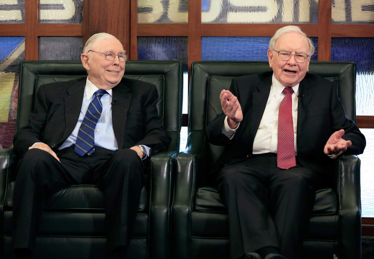 Berkshire Hathaway Chairman and CEO Warren Buffett, right, speaks alongside Vice Chairman Charlie Munger, Monday, May 4, 2015.  The annual Berkshire Hathaway shareholders meeting took place over the weekend in Omaha with over 40,000 in attendance.