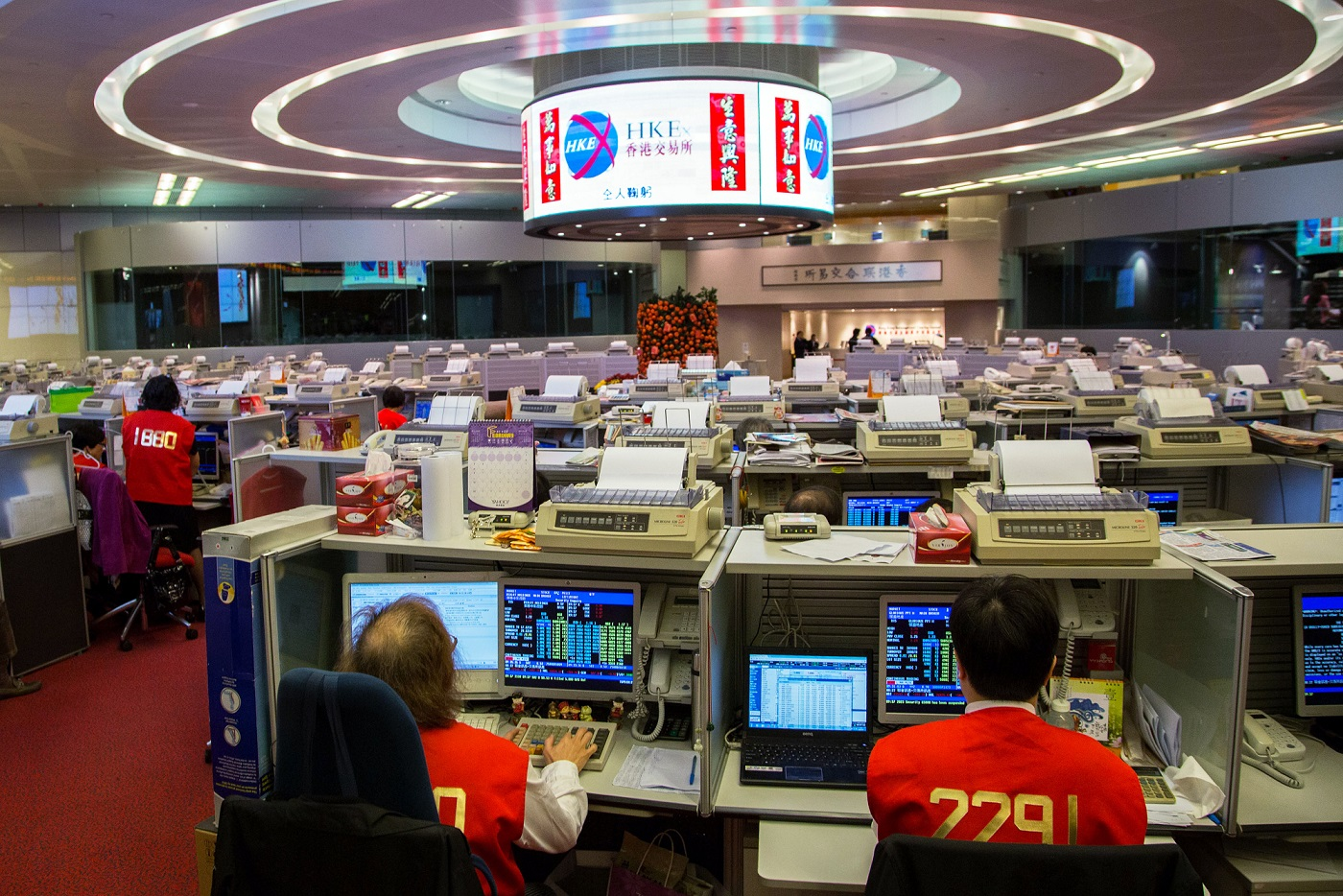 Traders work on the trading floor of the Hong Kong Stock Exchange during the first day of trading after Chinese New Year in Hong Kong, China, on Tuesday, Feb. 4, 2014. Hong Kong stocks tumbled on high volume, with the benchmark index poised to cap a 11 percent fall from a December peak, after weaker-than-expected manufacturing growth from the U.S. to China fueled a global equities rout. Photographer: Lam Yik Fei/Bloomberg via Getty Images