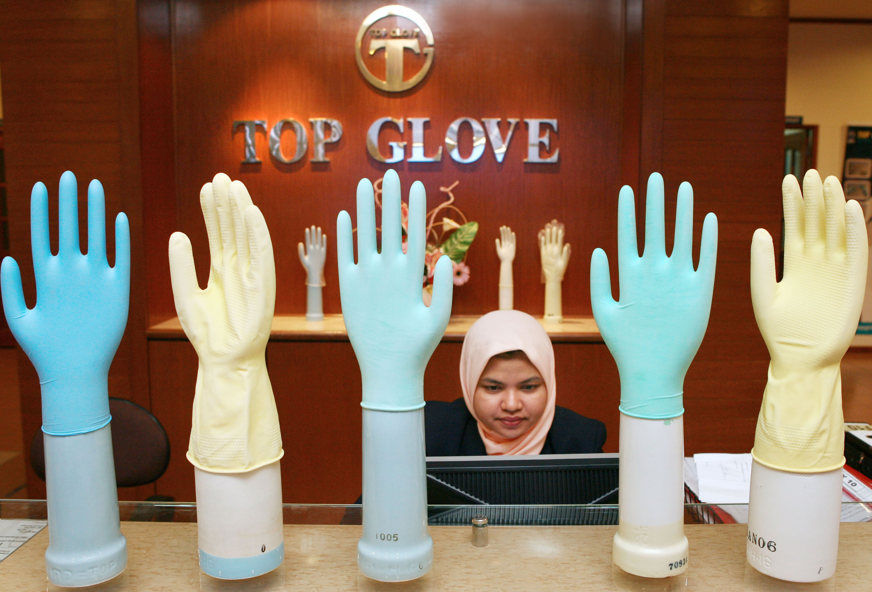 Colorful gloves greet visitors at the reception of Top Glove Factory in Meru ,Klang. Malaysia.Wednesday.10th.January.2007.Photographer:Goh Seng Chong./Bloomberg News